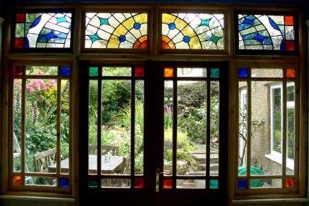 Repairs to stained glass martinez glass for Modern glass window design